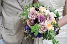 Clematis, garden rose bridal bouquet by Finch & Thistle Seattle $225