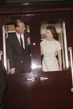 1961 Prince Philip and Queen Elizabeth together on a train they were departing in Manchester during the spring of 1961.