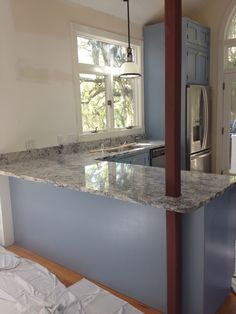 The granite on the sink wall and peninsula. It's called Carolina White.