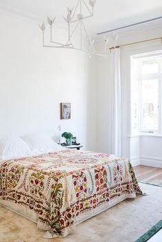 suzani bedspread, modern lighting, clean palette, gypset chic, simple design