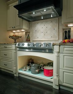 Granite Countertops Albany Ga : Off-white cabinets and granite countertops, stainless steel stove tops ...