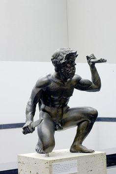 Kneeling Satyr, Greek statue (bronze), 4th century BC, (Staatliche Antikensammlungen, Munich).