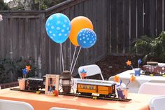 LOVE the trains and latterns as center pieces/decor!