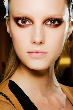 Backstage at Gucci Fall/Winter 2013-2014 in Milan - copper eyeshadow