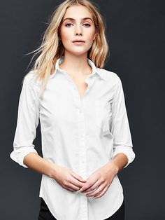 """Fitted boyfriend oxford shirt - These tops were made by women that participate in <a href=""""http://www.gap.com/pace""""> P.A.C.E. </a>, our education program that gives women the skills and confidence to change their lives."""