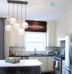 Remodelando la Casa: How my Kitchen is Holding Up - painted cabinets