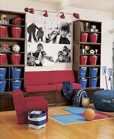 These colored storage pails are so amazing and perfect for a boy play room. Recently, my sister-in-law painted a red wall and had large black and white pictures made of her kiddos.  So, if you have a large wall to fill – consider large b/w pics of the kids. I'm sure there are cheaper places, but I use Shutterfly, you can upload any digital pic, turn it black and white, and the do large pictures that turn out amazing. I recently had one done for my game room.