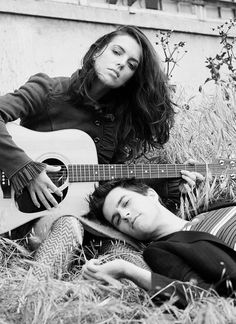 I like this but with her laying in his lap and him holding the guitar.