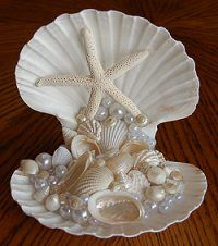 Sea shell wedding cake topper........Follow Us: www.jevelweddingplanning.com www.facebook.com/jevelweddingplanning/ https://plus.google.com/u/0/105109573846210973606/ www.twitter.com/jevelwedding/