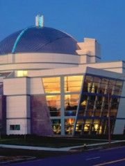 St. Louis Science Center.  A great place to take kids or go on your own.  Yet another free attraction in St. Louis.  http://www.slsc.org/