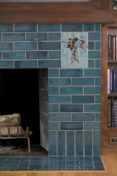 This multi-tone blue craftsman fireplace is accented with some artistic tile. The main tile is only one glaze that has a high variation to it making it seem more dimensional in the space. home handmade Blue Arts & Crafts Handmade Tile Fireplace Fireplace Hearth Tiles, Fireplace Remodel, Fireplace Mantle, Fireplace Surrounds, Fireplace Design, Fireplace Ideas, Glass Tile Fireplace, Craftsman Tile, Craftsman Fireplace