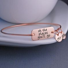 Oh, the Places You'll Go! This inspirational quote by Dr. Seuss is engraved on a bracelet available in silver, gold, and rose gold. It's a wonderful way of saying congratulations and makes a great graduation gift! Shop Love, Georgie for unique gifts today!