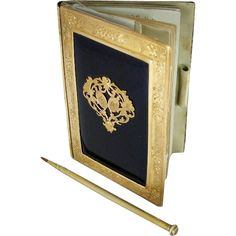An ormolu mounted and guilloche enamél carnet de bal in a book form. French Mid 19th century