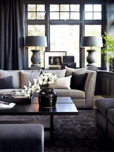 #TGIFabulous. We're nearing the end of our #DarkAndDreamy week, but we'd be remiss if we left out this beautiful living room featuring brooding colors with just enough light to balance them out.