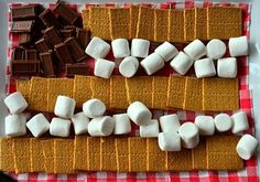 Enjoy these4th of July S'Mores Chocolate Treats, and a great way of displaying your party ingredients, in patriotic style!
