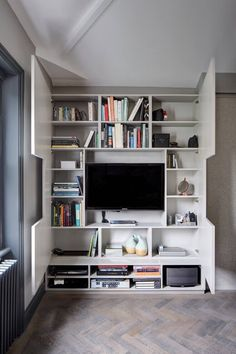 Amazing Storage Space Built In Around The TV, Including Multiple Shelves  And Cubbies And Paneled Wall Coverings For The Door
