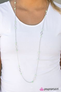 Green beading and shimmery silver accents trickle along a shiny silver chain, creating a rustic palette. Features an adjustable clasp closure.    Sold as one individual necklace. Includes one pair of matching earrings.