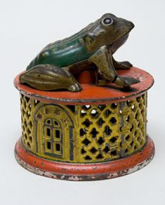 Frog on Round Base Antique Mechanical Bank »    Circa 1882: Manufactured by J. and E. Stevens, the Frog on Round Base was issued in many color combinations.
