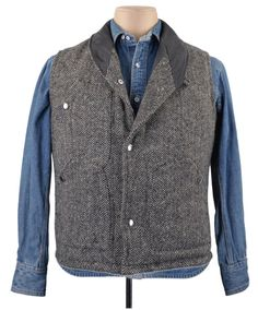 http://chicerman.com  luxirecustom:  Luxire quilted vest made inMolloy Herringbone Donegal Tweed - Grey  Consists of shawl collar chest pocket 2 hip pockets and leather backed snap buttons.  #menshoes