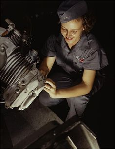 Mary Josephine Farley repairs a motor. Photographed by Howard R. Hallem in August 1942