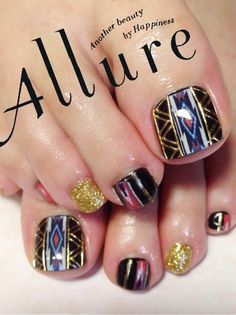 Pretty pedicure: Shiny Native American-theme design. I'm not one to follow trends, but this design is just cool!