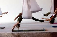 Aerial Yoga. I bet this is a really fun class and you feel really good when it is over. I wonder if any are offered in my area ☺