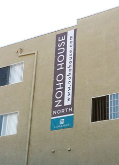 Vertical banner high on building. Designed, fabricated, and installed by Outdoor Dimensions.