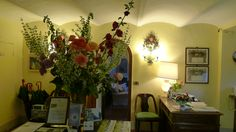 Hollyhock, roses, sage , in our reception