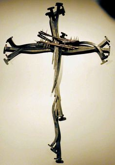 cross comissioned for Custer Rd United Methodist Church app. 8'/14' forged tube, square, and round steel. A puzzle.