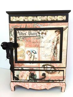An altered A Ladies' Diary jewelry box. graphic45
