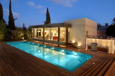 Appealing Frontyard Decor near Contemporary Swimming Pool surrounded with Wooden Floor at Poolside also Bay Windows on Frontside Wall with Bright Lighting - Swimming Pool Design as Modern Home Additional Feature – VizDecor