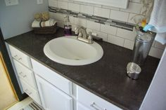 diy bathroom, white cabinet, pine counter top, ood counters, dark wood stain, subway tile bathroom, gray bathroom, master bathroom ideas. To see more click on post or visit http://ourhousenowahome.com/