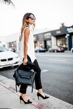 White sleeveless turtleneck + black crop flare pants + bow pumps