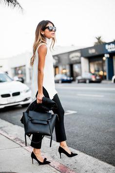 White sleeveless turtleneck + black crop flare pants + bow pumps