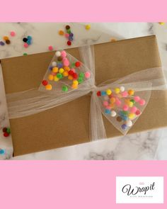 bow filled with mini pom poms, fun, colourful gift wrap for birthdays. Tulle bow filled with mini pom poms fun colourful gift wrap for birthdays.Tulle bow filled with mini pom poms fun colourful gift wrap for birthdays. Creative Gift Wrapping, Present Wrapping, Creative Gifts, Gift Wrapping Bows, Wrapping Papers, Birthday Gift Wrapping, Christmas Gift Wrapping, Birthday Gifts, Gift Wrapping Ideas For Birthdays