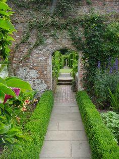 Boxwood lined walk way through Sissinghurst Castle Garden
