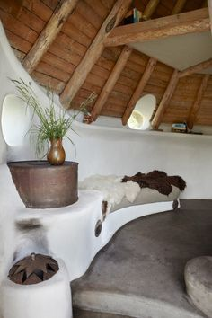 The Thatched Cottage, Denmark. The rocket stove with bench in the COB house http://www.organicholidays.co.uk/at/3419.htm