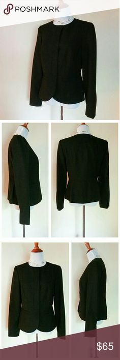 "NWOT Jones New York Stretch Solid Black Blazer From Jones NY, is a classic, fully lined, well tailored black blazer. There are hidden fabric covered snap closures both down the front and at the bottom sleeves. It is made from 62% polyester, 33% viscose, & 5% elastane, and is dry cleanable. The measurements across are:  shoulder to shoulder 14 1/4"", bust 17 3/4"", waist 16"", base hem 21 1/2"". The length is 23 3/4"". The arm length is 24 1/2"". There is a tiny flaw. One interior fabric tag has…"