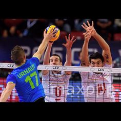Tine Urnaut (L) of Slovenia spikes the ball against Benjamin Toniutti (C) and Nicolas Le Goff (L) of France during the final between France and Slovenia at the men's 2015 CEV Volleyball European Championship in Sofia, Bulgaria, 18 October 2015.  EPA/VASSIL DONEV/MaxPPP #photo #photos #pic #pics #picture #pictures #art #beautiful #instagood #picoftheday #photooftheday #color #exposure #composition #focus #capture #moment #sport #photojournalism #photojournalisme #volleyball