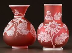 TWO ENGLISH CAMEO GLASS VASES. Two cameo glass vases patterned with wildflowers, circa 1890.