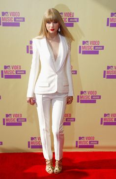 I would love to own a really nice pant suit! Most people were not into Taylor Swift's outfit choice for the 2012 VMA awards, I love this outfit especially with the red lips and nails and the sleek hair, but this is more 'business' then VMA!