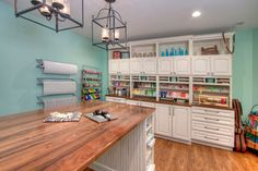 Green+Craft+Room+with+Custom+Cabinetry+and+Large+Crafting+Work+Surface