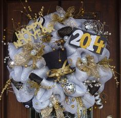 This is a very large and sparkly wreath to welcome your party guests on New Years Eve! It is made with deluxe deco mesh and features a glitter hat, a 2014 sign, a Happy New Year sign and lots of New Years sparkle Deco Mesh Wreaths, Holiday Wreaths, Holiday Crafts, Wreath Crafts, Diy Wreath, Wreath Ideas, Happy New Year Signs, New Year's Crafts, Michael S