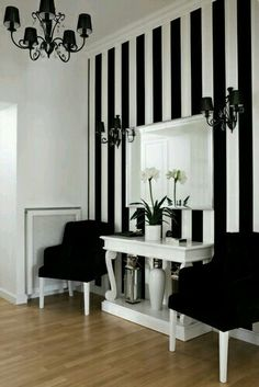 Really cool, I would've never thought to put vertical black and white stripes in the wall