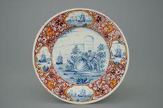 Een Delfts bord in gemengde techniek met romantisch decor, 18e eeuw
