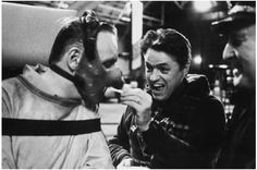 Sir Anthony Hopkins (Dr. Hannibal Lector) eating a French fry on the set of SILENCE of the LAMBS.