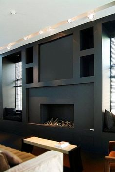Brining the whole wall plane out with fireplace and placing voids either side