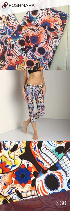 Onzie Sugar Skull Capris RePOSHing an adorable sugar skull print Onzie capri. S/M -- I simply have too many yoga pants and need to adopt my minimalist plan. No flaws. Never worn by me.                                             🚫No Trades 🚫PP 🚫Merc ✅Posh Rules ✅Use Offer Button ✅Bundles 20% off 3+ Item Onzie Pants Capris