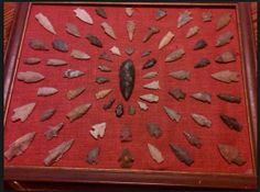 I have a collection of 50 arrowheads. I need to look around at a thrift store for a way to display using fabric and frame