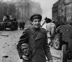 The Soviet poet Jewgeni Dolmatowski carrying his trophy—the cast head of Adolf Hitler, Berlin 2 May 1945